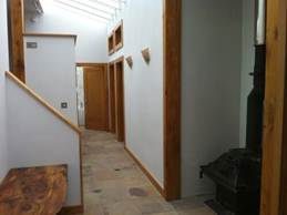 Hallway on lower level with stair to upper level